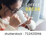 women drinking coffee break. | Shutterstock . vector #712425046