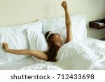 happy woman waking up after...   Shutterstock . vector #712433698