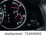 fuel gauge showing full car fuel | Shutterstock . vector #712434442