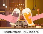 hands clinking beer people in... | Shutterstock .eps vector #712456576
