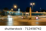 Roundabout and the church in Zory in the evening. Poland, Europe.