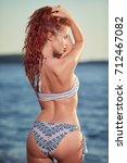 redhair woman in bikini relaxed ...   Shutterstock . vector #712467082