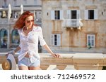 young woman walks on the... | Shutterstock . vector #712469572