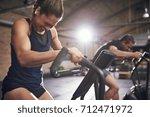 young sportsmen having hard...   Shutterstock . vector #712471972