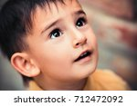 little boy portrait outside ... | Shutterstock . vector #712472092