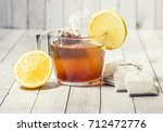 cup of tea with lemon on wooden ... | Shutterstock . vector #712472776