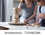 young girls and sister play... | Shutterstock . vector #712482286