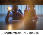the scared boy and girl lay on... | Shutterstock . vector #712486348