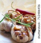 baked garlic | Shutterstock . vector #712486456