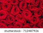 Stock photo red natural roses background 712487926