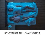 the couple sleeping and hold... | Shutterstock . vector #712490845