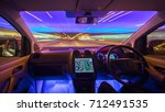 the man drive car in the city... | Shutterstock . vector #712491535