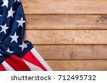 american flag wooden background.... | Shutterstock . vector #712495732