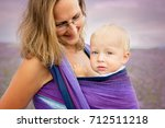 mother with a blond toddler in... | Shutterstock . vector #712511218