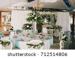 rich bouquet of white roses and ... | Shutterstock . vector #712514806