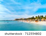 sandy beach in the high rise... | Shutterstock . vector #712554802
