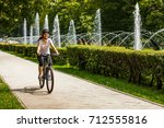 urban biking   young woman... | Shutterstock . vector #712555816