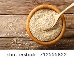Stock photo raw quinoa close up in a wooden bowl on the table top view from above horizontal background 712555822