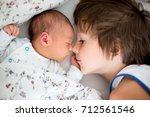 beautiful boy  hugging with... | Shutterstock . vector #712561546