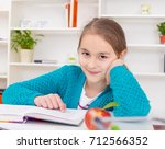 beautiful girl working on her... | Shutterstock . vector #712566352