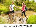 active beautiful young couple... | Shutterstock . vector #712574632