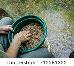 gold panning and gem mining. ... | Shutterstock . vector #712581322