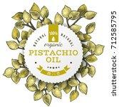 pistachio oil label over hand... | Shutterstock .eps vector #712585795