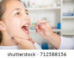 close up of little girl opening ... | Shutterstock . vector #712588156