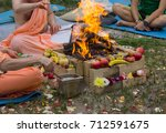 hindu ritual with cooking and... | Shutterstock . vector #712591675