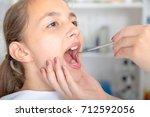 close up of little girl opening ... | Shutterstock . vector #712592056