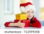 adorable little girl wearing...   Shutterstock . vector #712599358