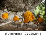 the old buddha image in trang ... | Shutterstock . vector #712602946
