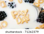 The words PAY DAY spelled out of letter shaped cereal pieces floating in a milk filled cereal bowl. - stock photo