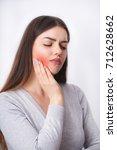 tooth pain. beautiful woman...   Shutterstock . vector #712628662