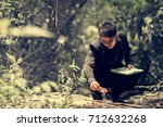 researching record data in the forest, Study woods in the asia - stock photo