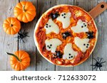 halloween pizza with ghosts and ... | Shutterstock . vector #712633072