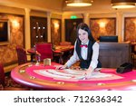 cute lady casino dealer at... | Shutterstock . vector #712636342