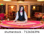 cute lady casino dealer at... | Shutterstock . vector #712636396