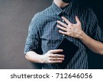 closeup on a man holding a... | Shutterstock . vector #712646056