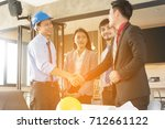 business people shaking hands... | Shutterstock . vector #712661122