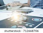 light bulb on document desk ... | Shutterstock . vector #712668706