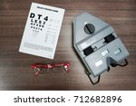 Small photo of Aerial view of vision card with red glasses and pupil distance meter used at a vision center to exam eyes.