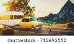 retro car with white trailer.... | Shutterstock . vector #712693552