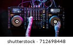 hand on a sound mixer station | Shutterstock . vector #712698448