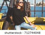 model wearing plain black t...   Shutterstock . vector #712744048