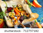 oven roasted vegetables with... | Shutterstock . vector #712757182