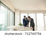 realtor showing apartments or... | Shutterstock . vector #712765756