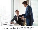 general manager presenting an... | Shutterstock . vector #712765798