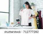online women sellers are... | Shutterstock . vector #712777282