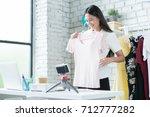 online women sellers are... | Shutterstock . vector #712777282